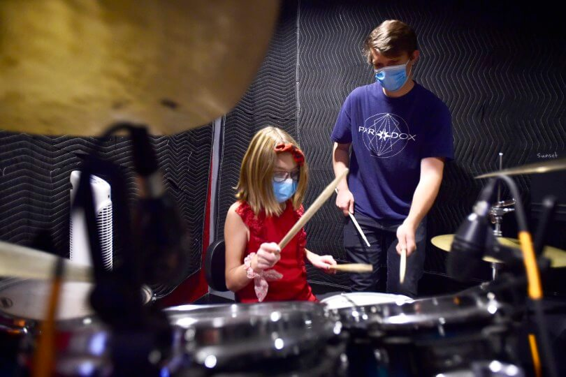 School of Rock teacher practicing drums with student