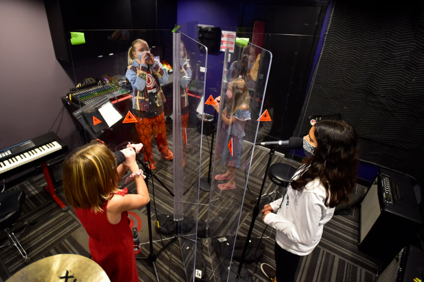 School of Rock singing teacher practices with students