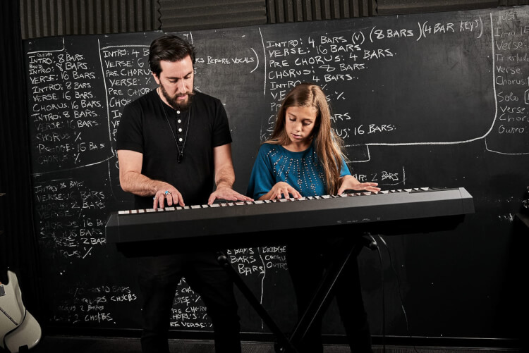 Instructor and student taking advanced keyboard and piano lessons
