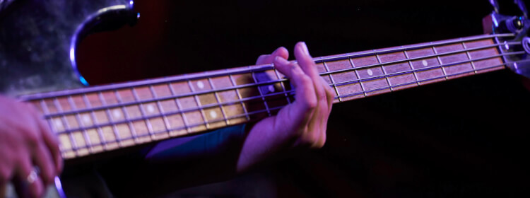 Kid learns to play bass at School of Rock Florence