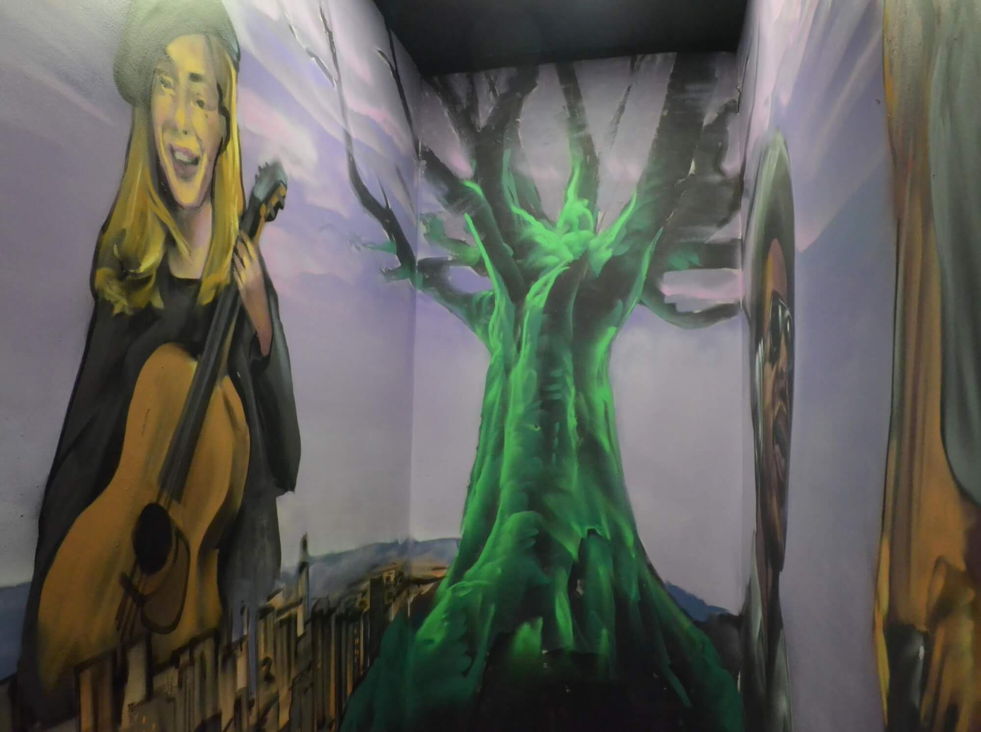 The outside of our venue space overlooks a mural of Joni Mitchell and the Tree of Life.
