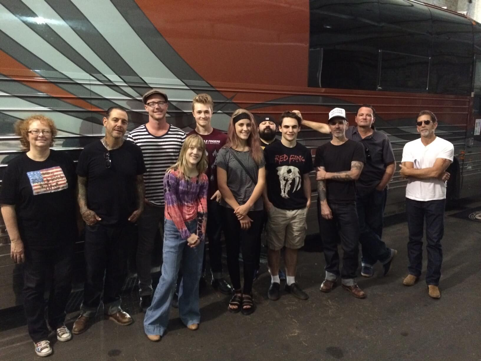 Social Distortion invited School of Rock students to their soundcheck while the band was performing at First Ave. in Minneapolis. Here we are, in the garage, with the band by their bus.