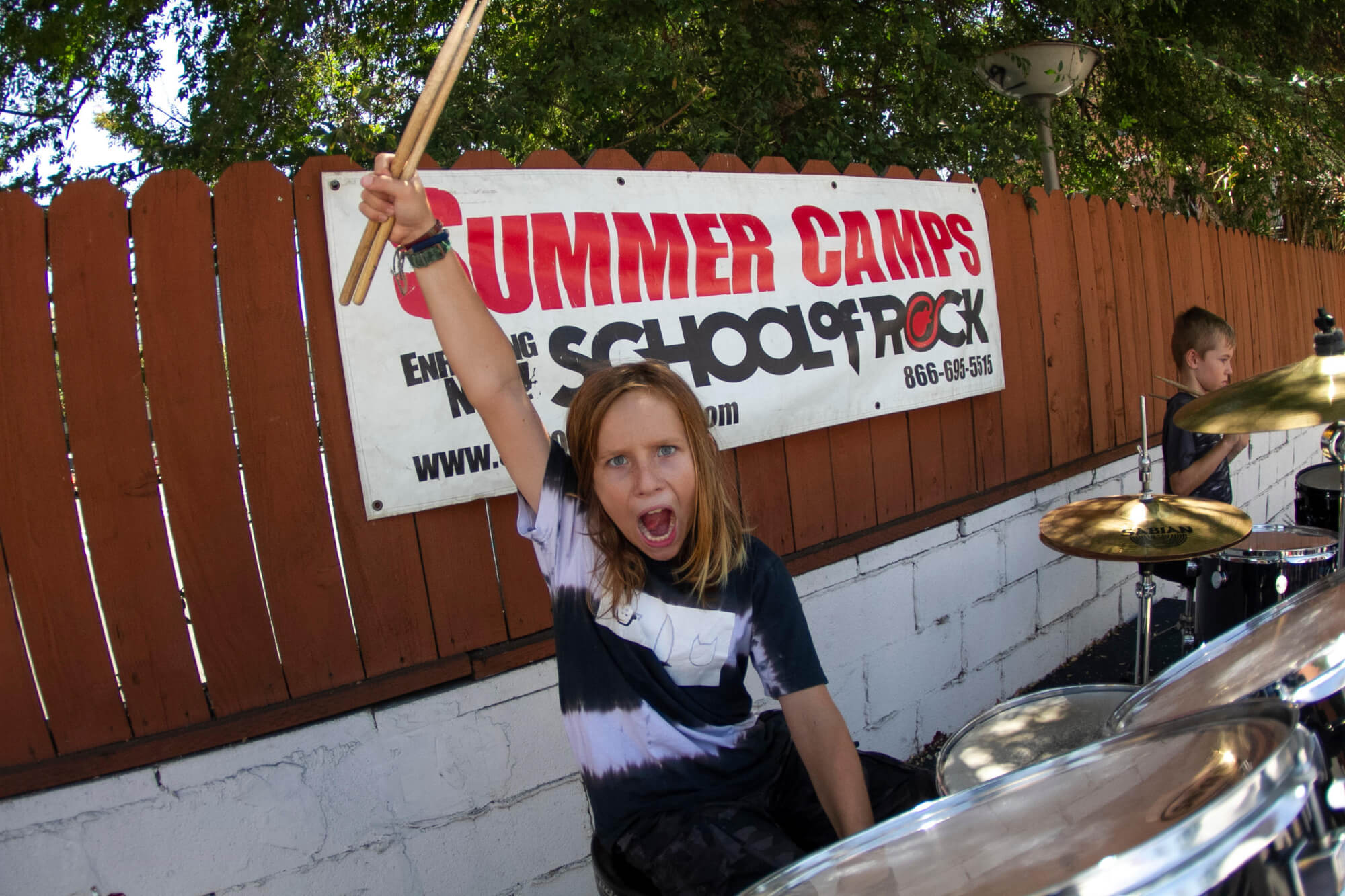 Our summer camps get kids of all skill levels playing together in a band.