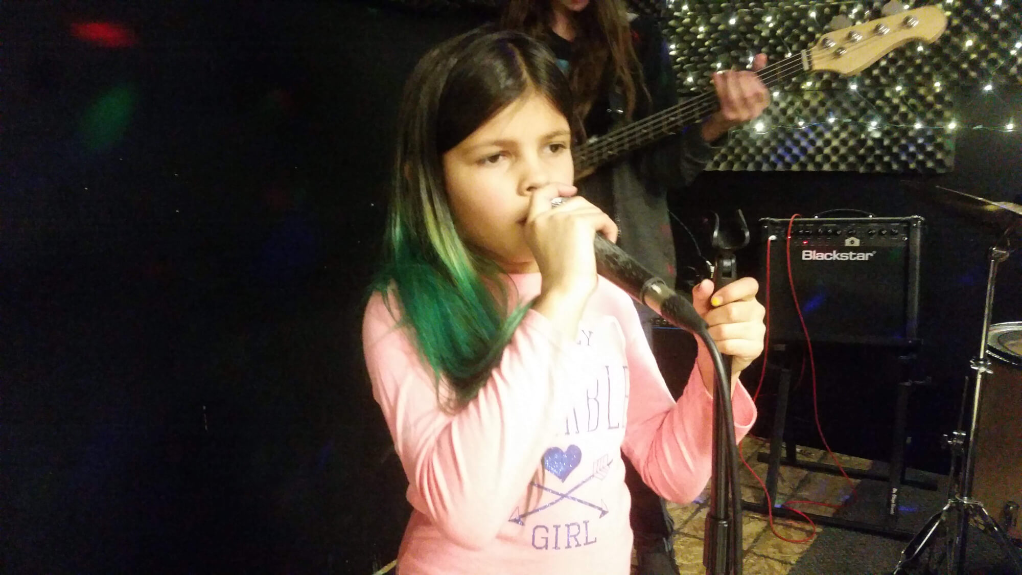 One of our students practicing her vocals during rehearsal.