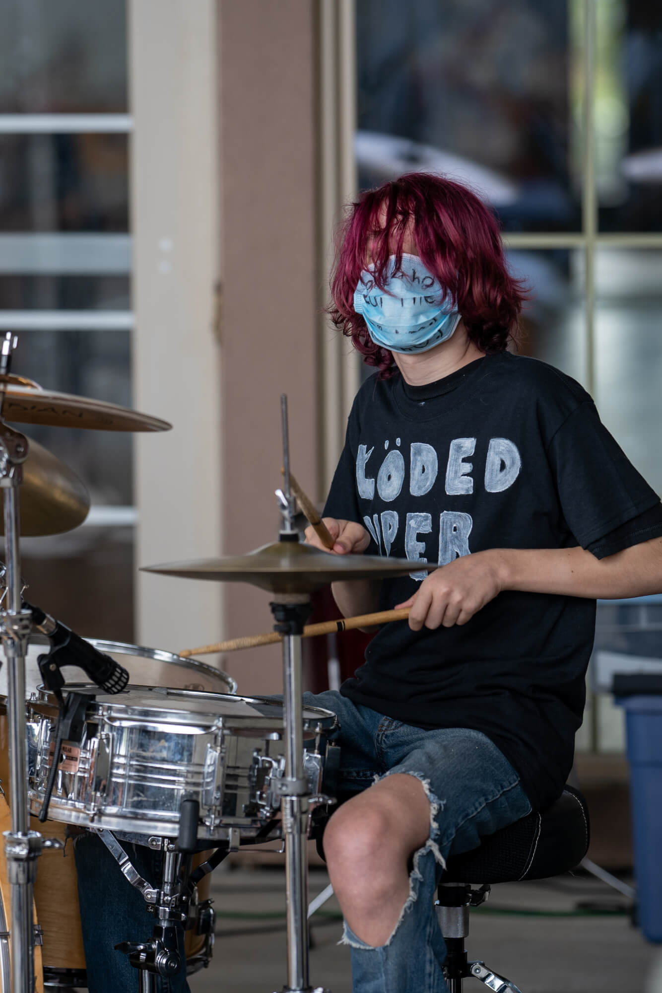 School of Rock student performs on stage.