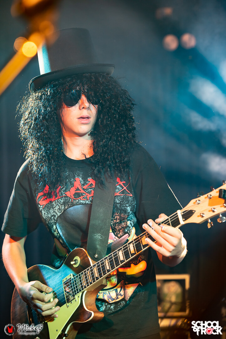 One of our students performs as Slash at our Guns n Roses performance.