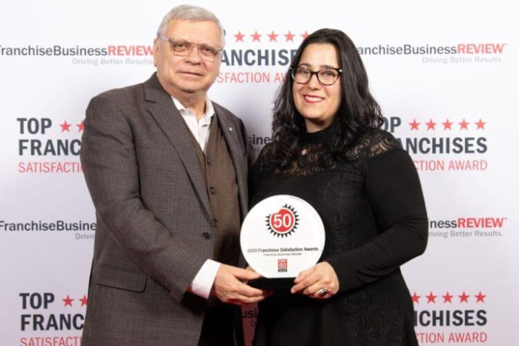 School of Rock corporate team accepts award