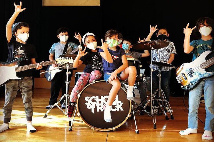 School of Rock students learning how to play music and preparing for show in Colorado Springs