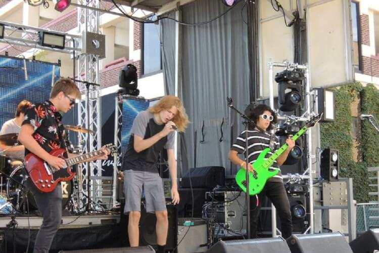 Young musicians from Elmhurst's School of Rock entertained at Rock the Block. (Graydon Megan / Pioneer Press)