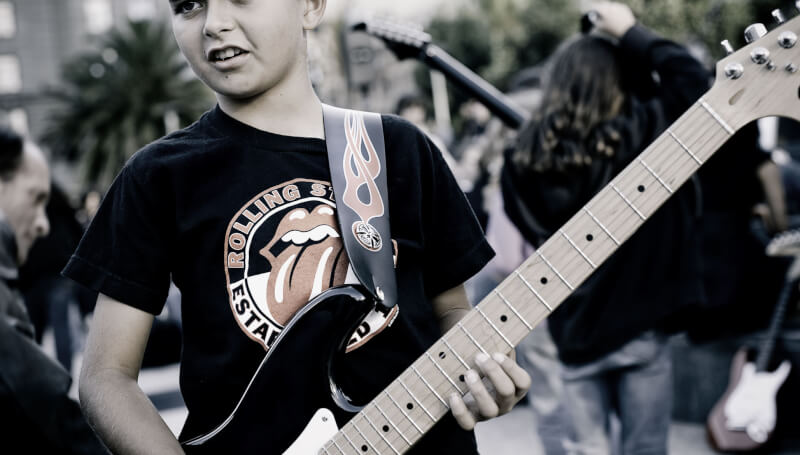 boy holding a guitar
