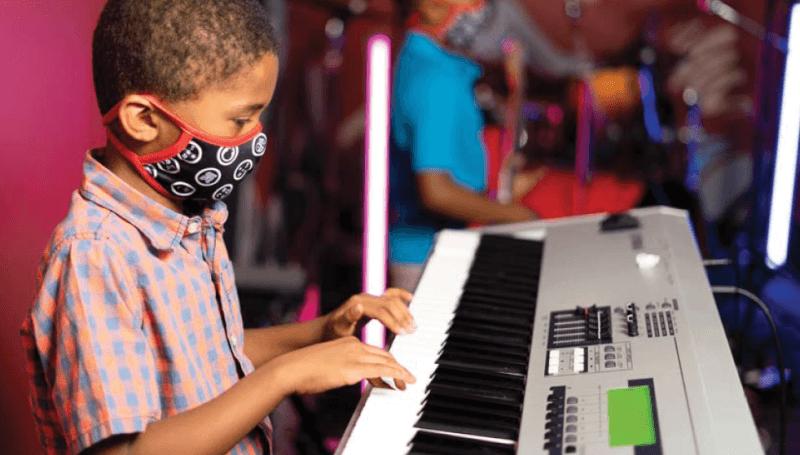 School of rock student playing keyboard