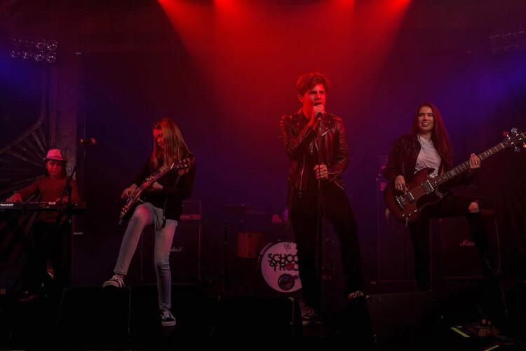 School of Rock students performing original songs
