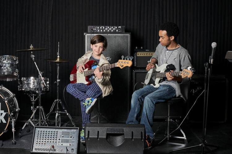 Student learning to play in rock programs for kids