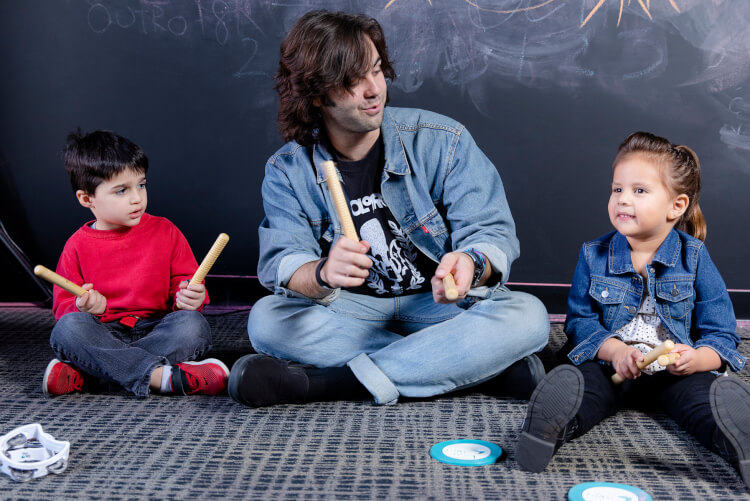 Students learning music basics with instructor