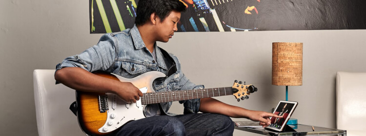 Remote student playing guitar
