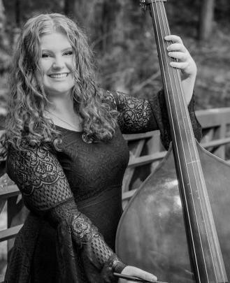 Brienna Watson is a singing teacher and bass teacher at School of Rock