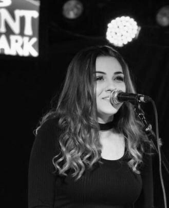 Amanda Conti is a singing teacher and keyboard teacher at School of Rock Clark