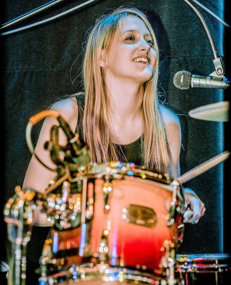 Katelynn Corll - Drum, Guitar, Bass Guitar, Keyboard, and Singing Teacher, Show Director